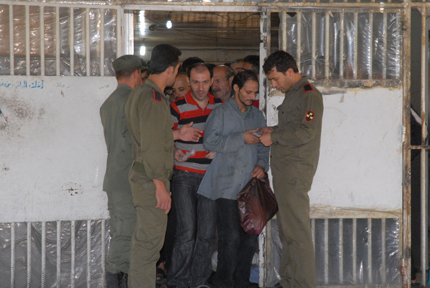 "A handout picture released by the official Syrian Arab News Agency (SANA) shows some of the 274 inmates being readied for release from the Damascus Central Prison on June 11, 2014. Several dozen prisoners were also released from Syrian government custody on June 10 after a general amnesty announced by President Bashar al-Assad, a human rights lawyer told AFP.  AFP PHOTO/HO/SANA == RESTRICTED TO EDITORIAL USE - MANDATORY CREDIT ""AFP PHOTO / HO / SANA"" - NO MARKETING NO ADVERTISING CAMPAIGNS - DISTRIBUTED AS A SERVICE TO CLIENTS === / AFP PHOTO / SANA / -"